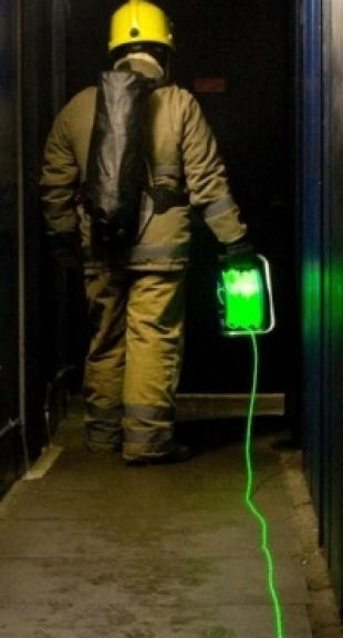 Firefighter with fibreoptic cable
